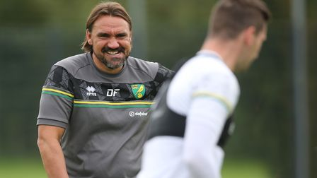 Norwich Head Coach Daniel Farke jokes with Kenny McLean of Norwich during training at Hotel-Residenc