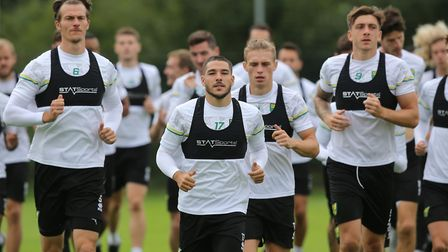 Head Of Sports Science Chris Domogalla takes the Norwich players for a run during training at Hotel-