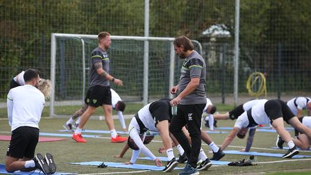 Norwich Head Coach Daniel Farke watches his players stretch out before training at Hotel-Residence K