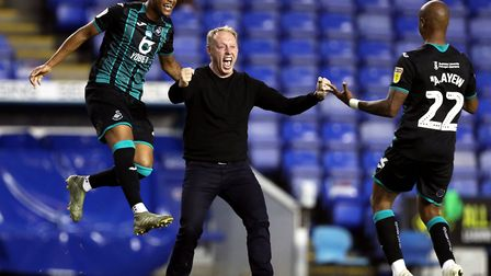 Swansea boss Steve Cooper celebrated with his players after sneaking into the Championship play-offs