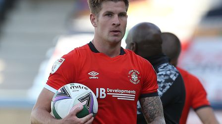 Hat Trick hero James Collins of Luton Town with the match ball at the end of the game. Picture: Pau