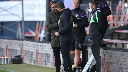 The two managers shake hands at full-time. Picture: Paul Chesterton/Focus Images Ltd