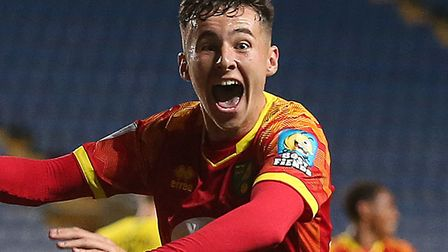 Tom Scully, pictured celebrating after Shae Hucthinson had scored for Norwich City Under-21s at Oxfo