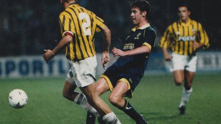 Chris Sutton in Norwich City's blue away kit at Vitesse Arnhem in the Uefa Cup in 1993 Picture: Arch