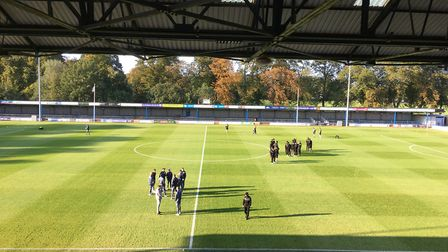 Players inspect the pitch before the friendly at The Walks Picture: Chris Lakey