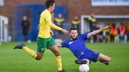 King's Lynn Town's Rory McAuley slides into a tackle during the game against Norwich City U23s at Th