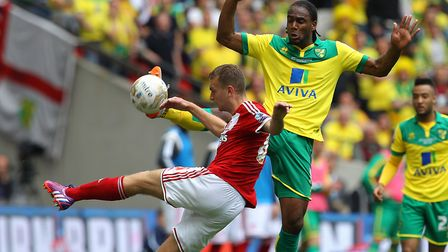 Ben Gibson challenges Cameron Jerome during the 2015 Championship play-off final at Wembley Picture