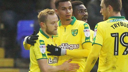 Alex Pritchard is congratulated after opening the scoring for Norwich at Birmingham City on Boxing D