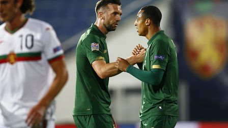 Welcome to the seniors... Adam Idah is greeted by Shane Duffy in Sofia Picture: PA