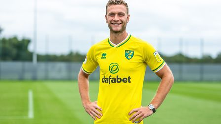 Norwich City's new loan signing Ben Gibson feels he is joining a club on the up despite relegation f