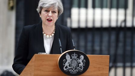 Prime Minister Theresa May addresses the media in Downing Street, London, after a suicide bomber kil
