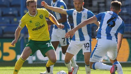 Oliver Skipp of Norwich, Alex Pritchard of Huddersfield Town and Jonathan Hogg of Huddersfield Town