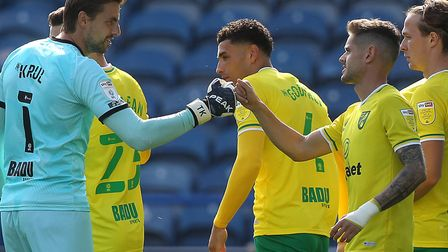 Canaries players Tim Krul, left, and Xavi Quintilla ahead of kick-off at the John Smith's Stadium Pi