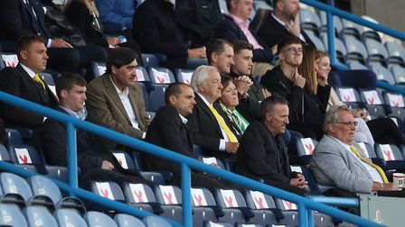 The Norwich board watch on during the Sky Bet Championship match at the John Smiths Stadium, Hudders