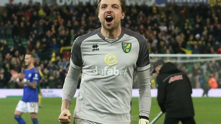 Tim Krul celebrates Norwich City's last victory at Carrow Road, a 1-0 win over Leicester in February