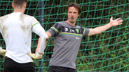 Norwich City goalkeeper coach Ed Wootten puts young keeper Daniel Barden through his paces during pr