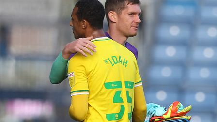 Michael McGovern congratulates striker Adam Idah on his winner at Huddersfield last weekend Picture: