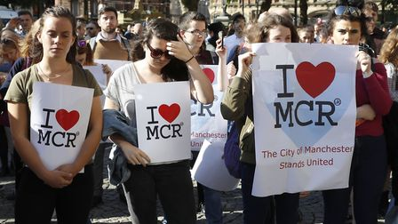 People gather ahead of a vigil in Albert Square, Manchester Martin Rickett/PA Wire