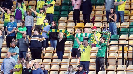 The home fans belt out On The Ball City before their Championship clash against Preston. Picture: Pa