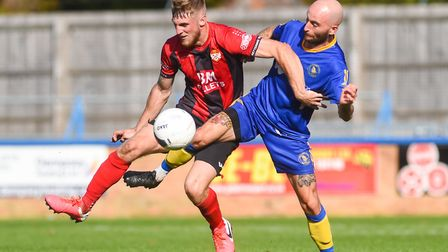 King's Lynn Town's Chris Henderson was penalised for this tackle Picture: Ian Burt