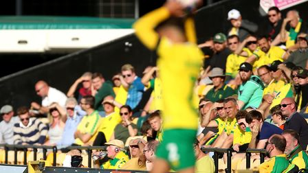 Norwich City's Max Aarons takes a throw in as fans watch the Sky Bet Championship match against Pres