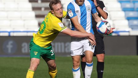 Oliver Skipp clashes with Alex Pritchard during Norwich's 1-0 win over Huddersfield on the opening d