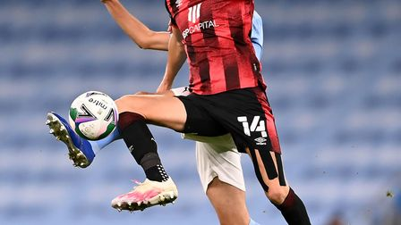 Sam Surridge scored an equaliser as Bournemouth lost 2-1 at Manchester City in the third round of th