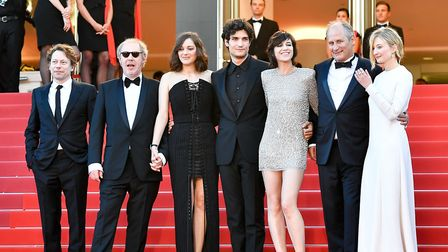 """French director Arnaud Desplechin (2nd L, Front) and other cast members of the opening film """"Les Fan"""