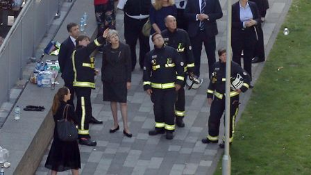 Prime Minister Theresa May visits the scene near Grenfell Tower