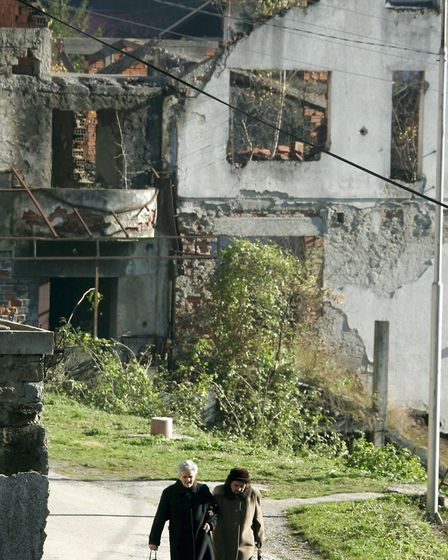 Two elderly women walk through Srebrenica, Bosnia and Herzegovina, 15 November 2006.