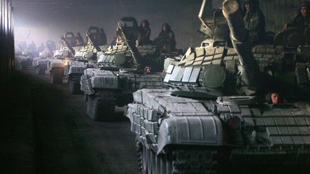 A column of Russian armoured vehicles moves towards the Roki tunnel.