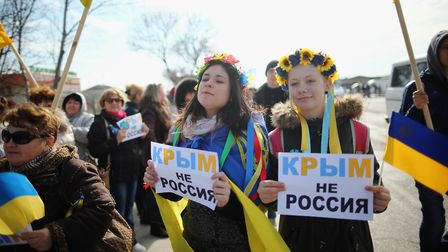 Two young Ukrainian women hold signs that read 'Ukraine not Russia'