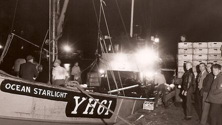 BUSY NIGHT: the Ocean Starlight uses lights as she lands her catch at Yarmouth in 1962. She won the