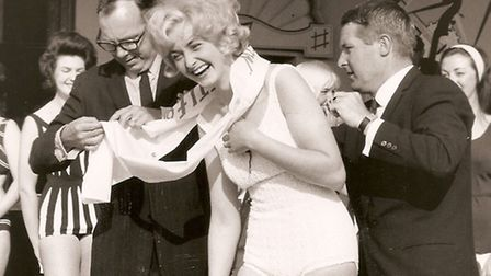 ERIC AND ERN...struggle to untangle a sash to put over a beauty queen's shoulders at the Marina in t