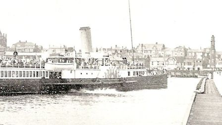 PORT OF CALL: a London passenger steamer negotiates the Yarmouth harbour bend early last century.