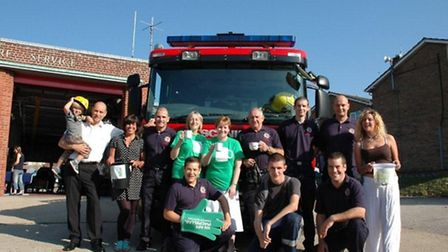 Thetford firefighters are taking part in the MacMillan Coffee Morning