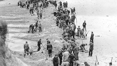 Floods 1953 - Sea PallingTroops, mostly Air Force seal a gap in the dunes at Sea Palling. Peter Ba