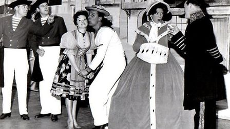 """THERE IS NOTHING LIKE A DAME! Derek Marshall, second right, in a scene from a Great Yarmouth """"Ops an"""