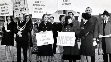 PROTEST: trade unionists line up, with William Parsons on their right.