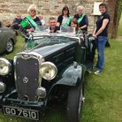 Members of the NSPCC and Bury St Edmunds Abbey Rotary Club at the classic car event in Elveden.
