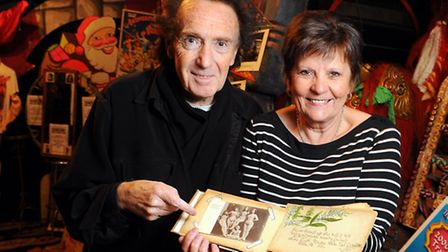 Margaret Churchill and Peter Jay with a tattered autograph book which contained photographs and auto