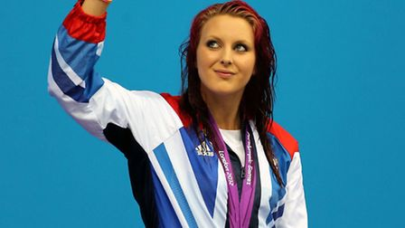 Gorleston's Jessica-Jane Applegate on the podium with her gold medal after the Women's 200m Freestyl