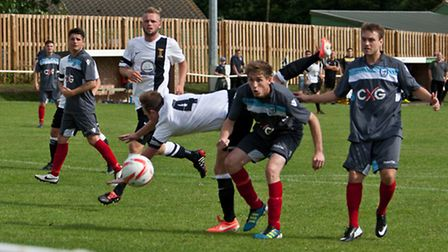 Swaffham Town captain Dean Miller sprawling to get the vital touch for Swaffham's second goal, Matth
