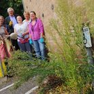 Jane Varanand and her team of volunteers weed the pathways in Thetford town centre.Picture by: Sony