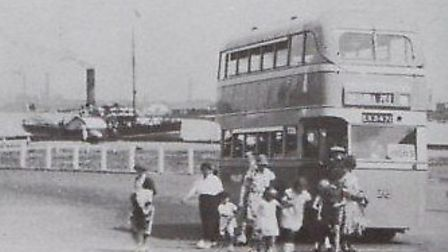 DESTINATION OF DELIGHTS: a Yarmouth Corporation bus discharges passengers near Gorleston Pier and be