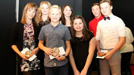 Thetford Dolphins Swimming Club captains hand over to the club's new captains for 2015 at the club's
