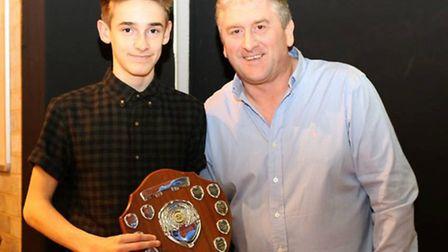 Alex Darton receives the Club Swimmer of the Year award from Thetford Dolphins Swimming Club head co