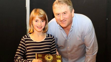 Alice Fasey receives the Most Improved Swimmer award from Thetford Dolphins Swimming Club head coach