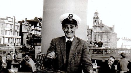 SNAPPER SNAPPED: a young Bob Jordan at the wheel of a pleasure boat, possibly the Queen of the Broad