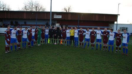 Thetford (red) and FC Clacton players join the Football Remembers campaign in memory of the First Wo